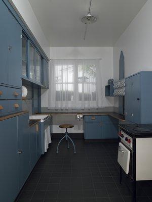 Margarete Schütte-Lihotzky (Austrian, 1897-2000), Frankfurt Kitchen, 1926-1930, Kitchen cabinetry and stove. Gift of funds from Regis Foundation, 2004.195.