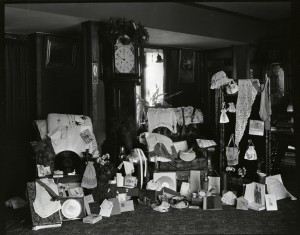 "A photograph taken at William Purcell's grandmother's house, the Catherine Gray House in Minneapolis, likely shows the wedding presents given to William and Edna in December 1908, including a waistcoat and tie for William, and nightgowns, stockings, and embroidered bags and purses for Edna—some of which may have been ""halfways."" (Photo courtesy William Gray Purcell Papers, Northwest Architectural Archives, University of Minnesota Libraries.)"