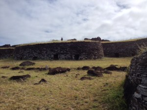 The reconstructed ceremonial house at Orongo, on Easter Island, where a moai, or statue of a giant head—now in the British Museum—once stood.
