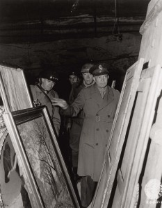 "The leading American generals of World War II, including Dwight Eisenhower (right) and George Patton (left), inspect artworks rescued by the Monuments Men. Eisenhower's orders to heed the advice of the Monuments Men to ""preserve centers and objects of historical and cultural significance"" gave them the credibility they needed within the military."