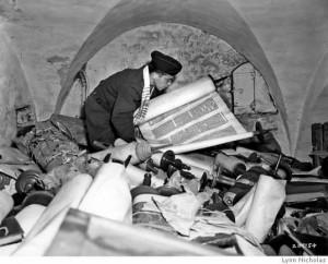 "A U.S. Army chaplain sorts through stolen Torah scrolls after the war in this photograph by Lynn Nicholas, author of ""The Rape of Europa,"" the seminal study of cultural destruction during World War II. Source: Lynn Nicholas."
