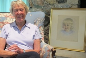Kitty Crosby at home with her Helen Baxter portrait.