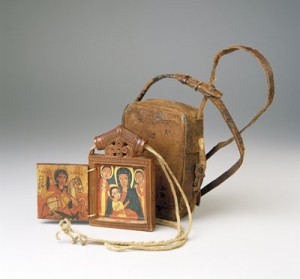 An icon and carrying case from Ethiopia, dating to the 18th or 19th century. Faithful travelers would wear icons like around the neck for protection.