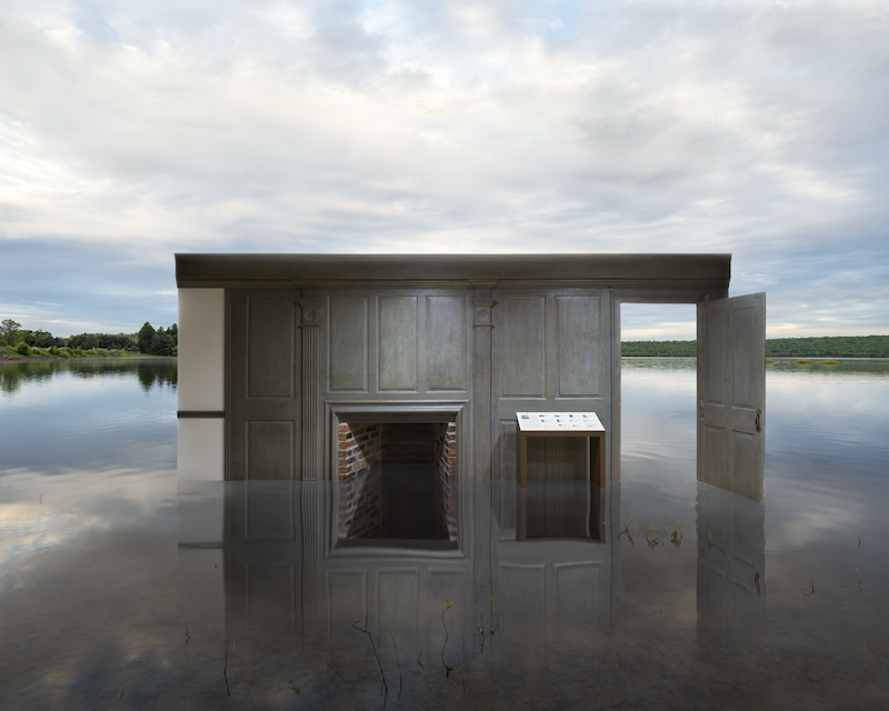 a wood paneled room half submerged in water