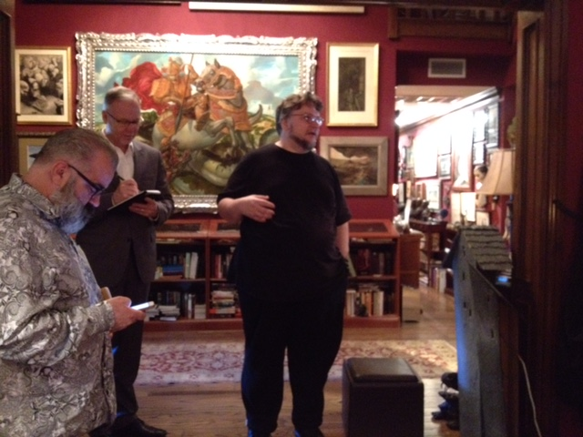 Del Toro, in black, giving museum officials a tour of Bleak House.