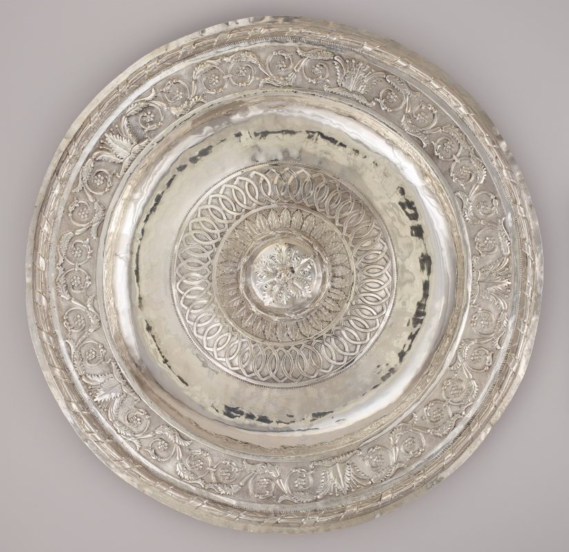 An engraved, silver Passover plate.