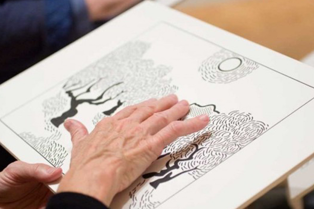 "A person feels a textured print of Van Gogh's ""Olive Trees"""