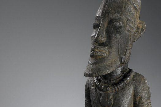 Wooden figure of a man.