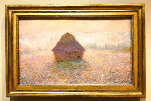 Claude Monet's painting Grainstack, Sun in Mist in its new, gold colored frame.