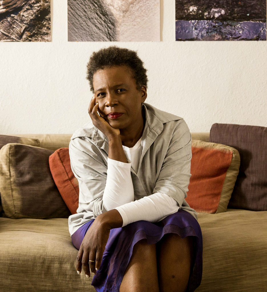 Claudia Rankine sitting on a couch
