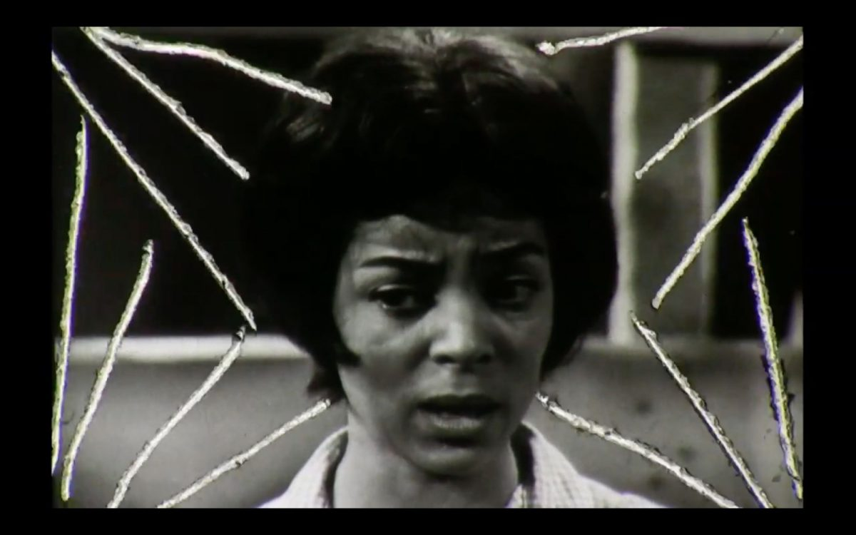 A black and white photograph of a black woman who looks very distressed.