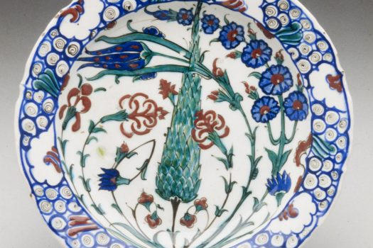 Ceramic plate painted with floral pattern in red, blue, and green