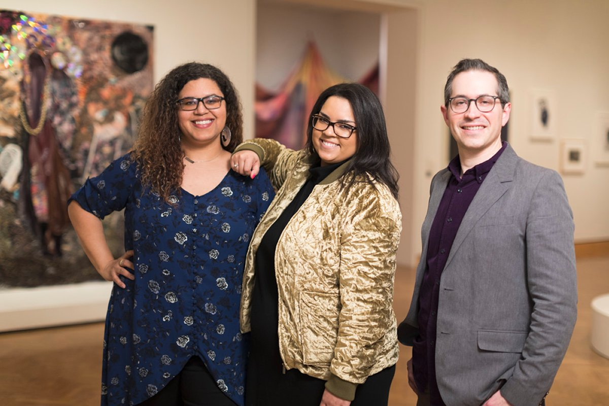 "Portrait of Esther Callahan (Art of Inclusion Fellow), Gabriel Ritter (Curator of Contemporary Art), and Keisha Williams (Curatorial Department Assistant and Artist Liaison) in Gallery 374 during the exhibition ""Mapping Black Identities""."
