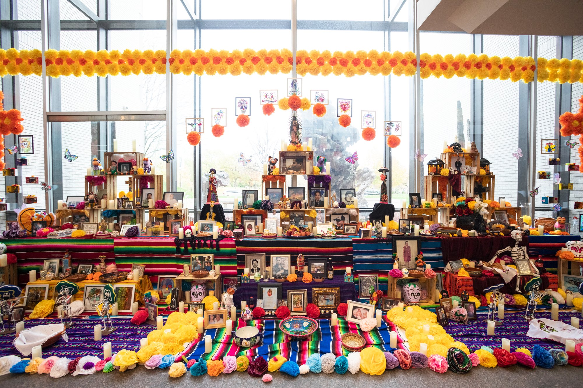 An image of an ofrenda installed in the museum lobby for Dia de los Muertos.
