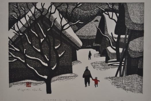 black and white woodblock print depicting a winter scene of houses and a tree covered in snow. An adult holds a child's hand in the foreground.